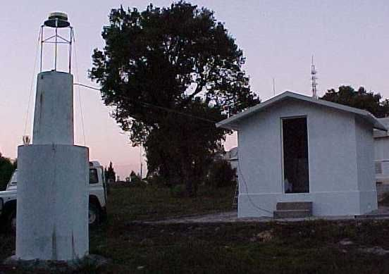 pillar, antenna and the house where the equipment is.