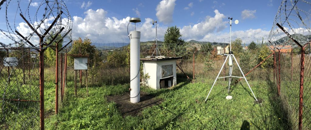 Panorama: concrete pillar with GNSS antenna and meteorological instruments