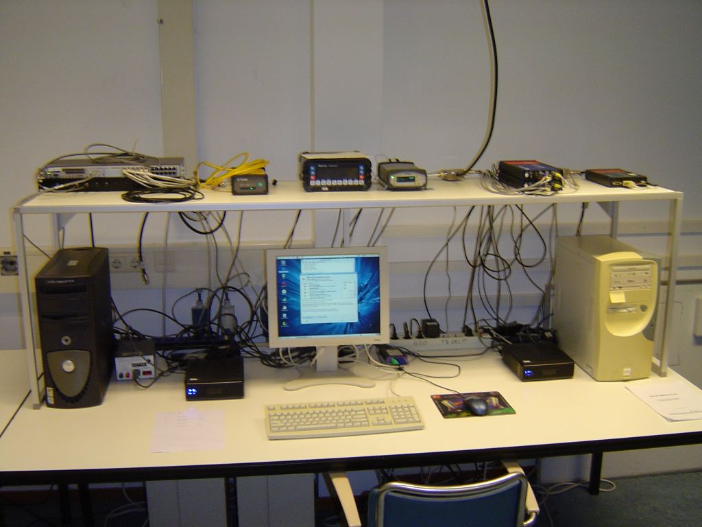 Inside the observatory with different receivers and logging equipment.The DLF1 receiver is the Trimble NETR9 in the middle.