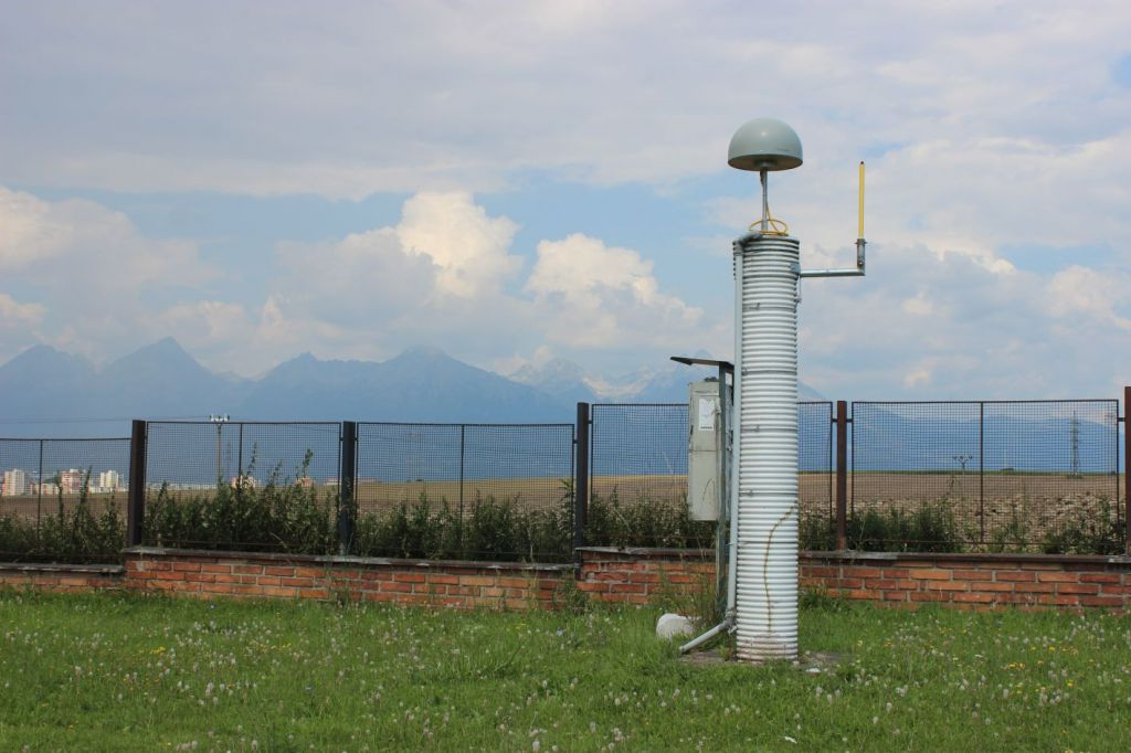 Monument: concrete pillar with GNSS antenna. North view with High Tatras