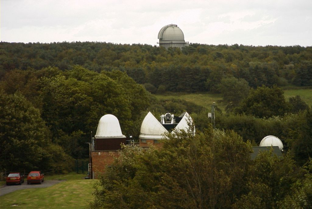 view back across site from top of water tower, showing SLR dome/telescope, radar dome and to the right the HERS and Met tower.