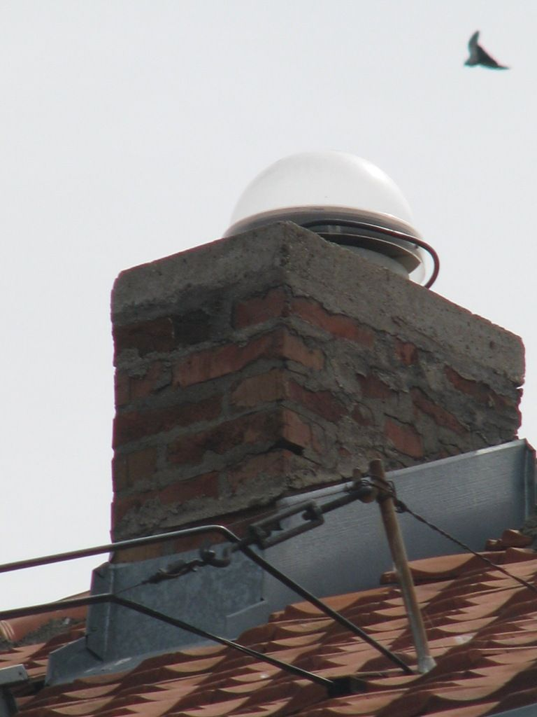 Existing Trimble Zephyr Geodetic antenna configuration w/Radome on the bricked chimney with belonging cable of type TRIMBLE SB3710 with label