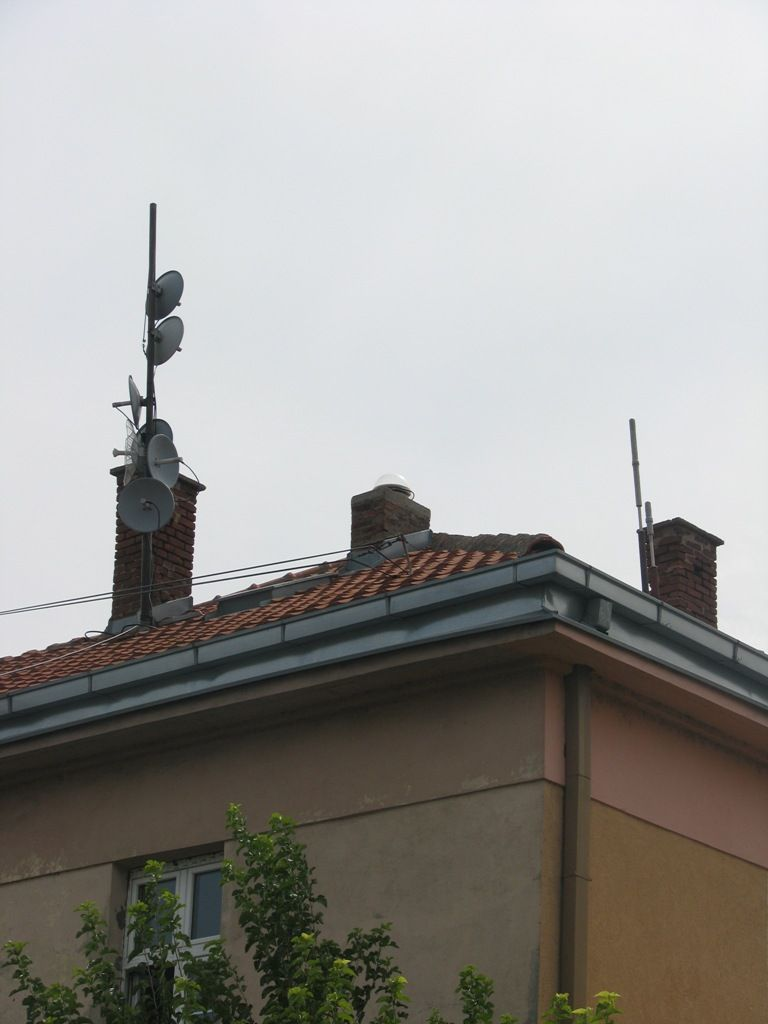 Local surrounding of GNSS antenna which is placed in the middle chimney near radio antennas and base stations for mobile telephone communication