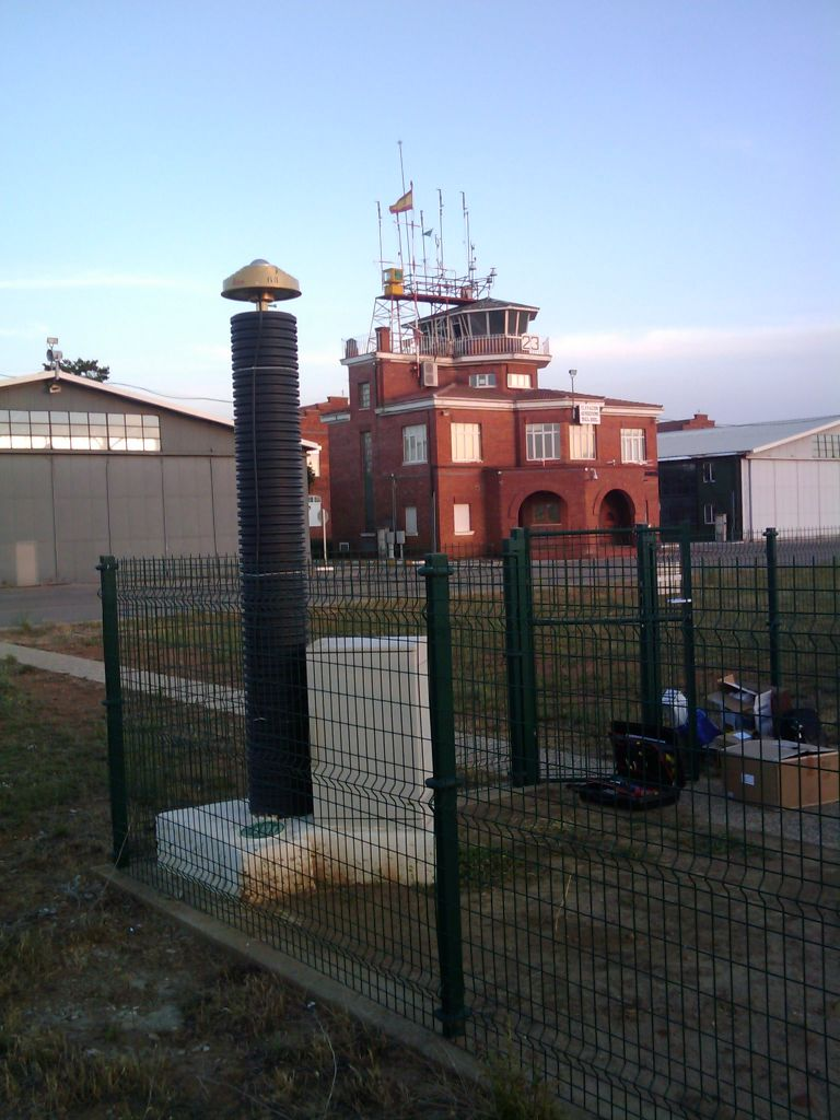 GNSS antenna and concrete pillar in Instituto Nacional de Meteorologia, Virgen del Camino Airport. View: from north to south.