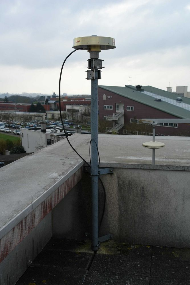 Leica AT504GG mounted on a steel mast on the roof of ESGT building. View in the direction East.