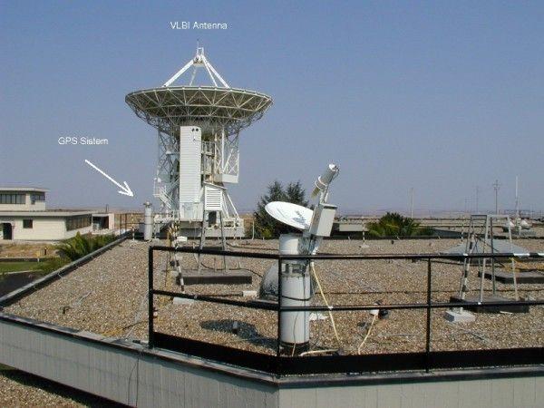 GPS antenna with pillar and VLBI antenna.