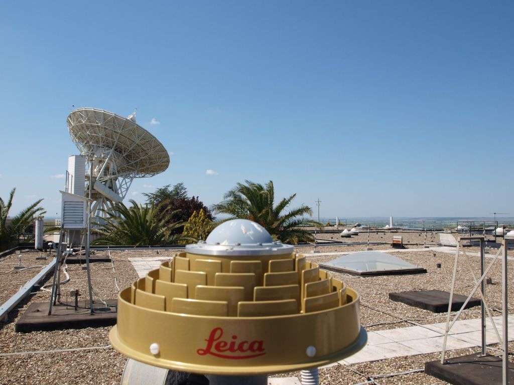 GNSS antenna and VLBI antenna looking at N-W
