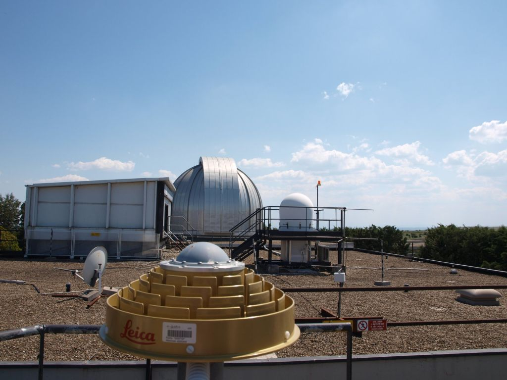 GNSS antenna and MLRO (SLR) dome looking at S