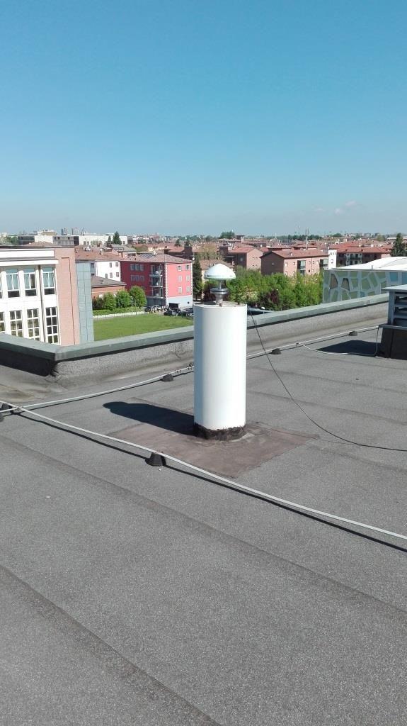 monumentation: reinforced concrete pillar on the roof of DIEF - University of Modena and Reggio Emilia.