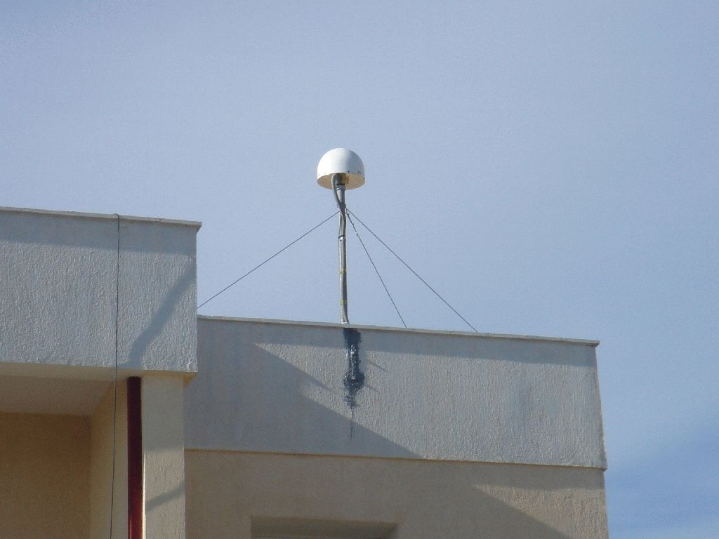 view of the antenna mast on the roof of the ISARS building.