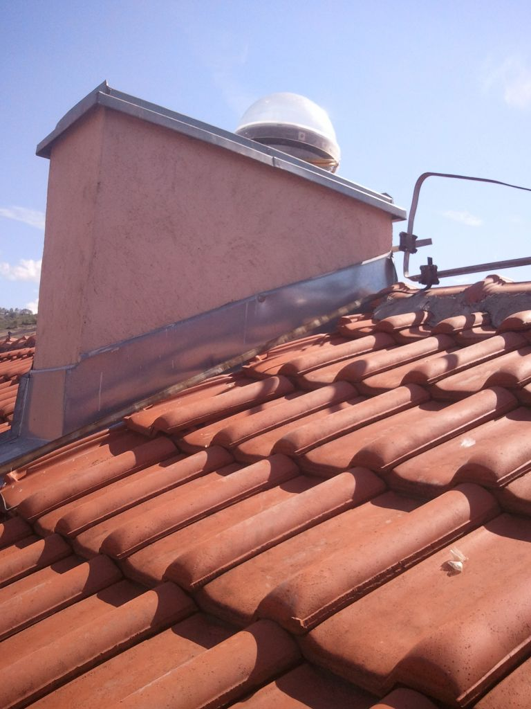 GNSS antenna of NPAZ station is installed on the aluminum plate which is attached to the concrete chimney on the roof of local cadastre