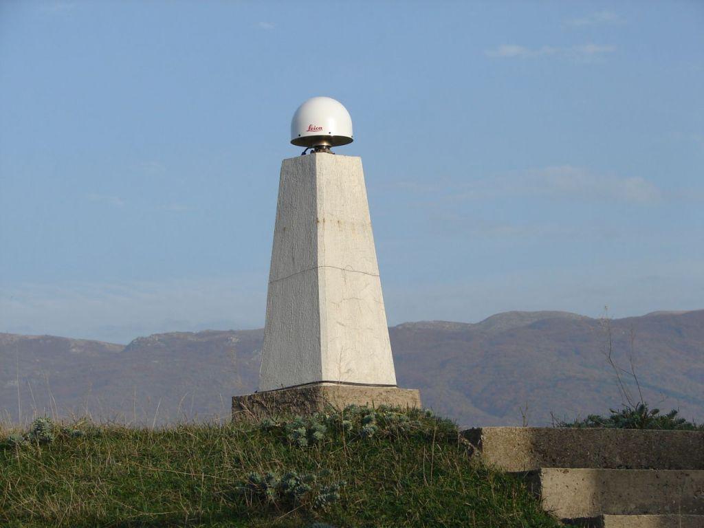 concrete pillar and GNSS antenna.
