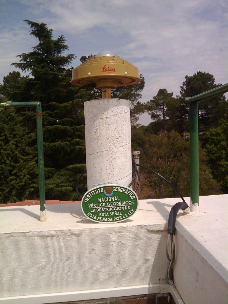 GNSS antenna and concrete pillar in Instituto Nacional de Meteorologia in Matacan Airport.
