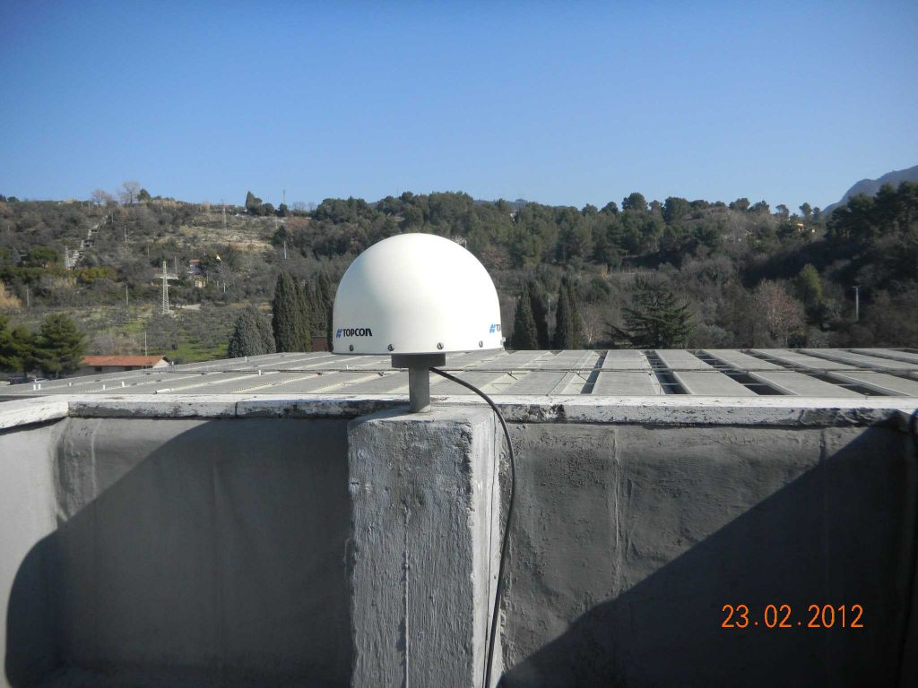 antenna and monumentation on the head of the pillar.