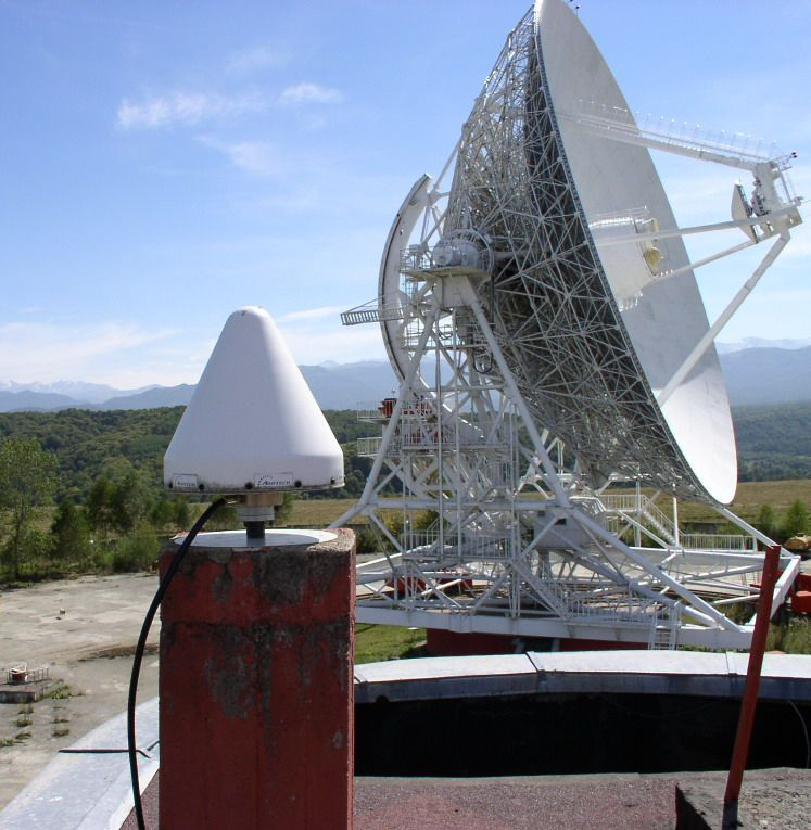 pillar, antenna, radome. In the background: the Zelenchukskaya Radiotelescope.